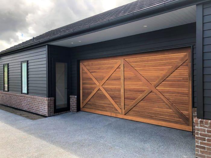 Custom Cedar Sectional Garage Door CP837 (61mm rusticated shiplap) with batten overlay